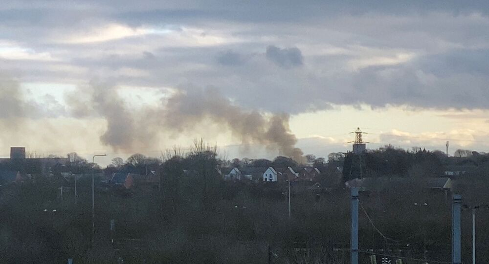 Smoke billows as fire breaks out at Napier Barracks, government housing for asylum seekers, in Folkestone, Britain January 29, 2021, in this still image obtained from social media video.
