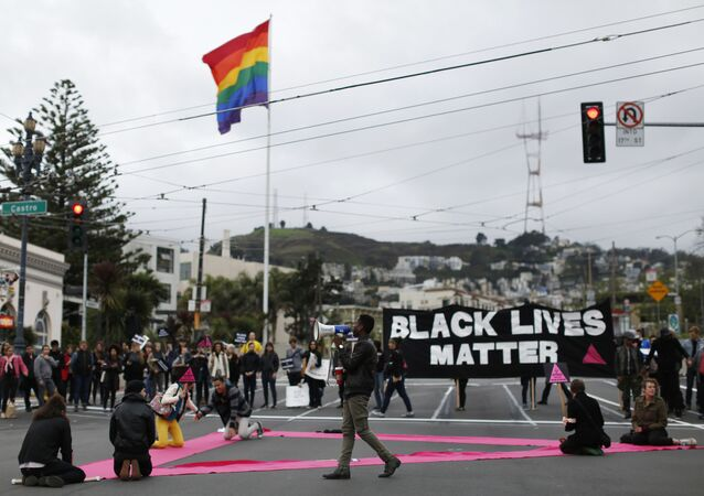 Demonstrators gather at the intersection on Market and Castro Street during a peaceful protest against police violence organized by the San Francisco LGBT Community Center in San Francisco, California December 24, 2014.