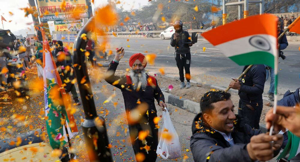 Farmers are showered with flower petals as they take part in a tractor rally to protest against farm laws on the occasion of India's Republic Day in Delhi, India, January 26, 2021.