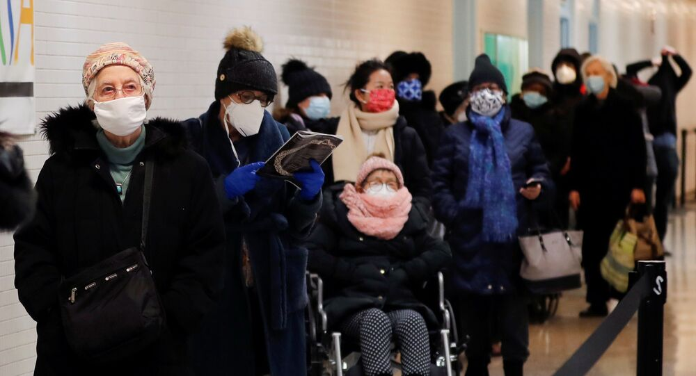 People wait in line to receive the Moderna COVID-19 Vaccine at a pop-up vaccination site operated by SOMOS Community Care during the coronavirus disease (COVID-19) pandemic in Manhattan in New York City, New York, U.S., January 29, 2021.