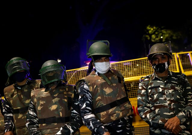 Paramilitary troops stand guard after an explosion near the Israeli embassy in New Delhi, India, January 29, 2021.