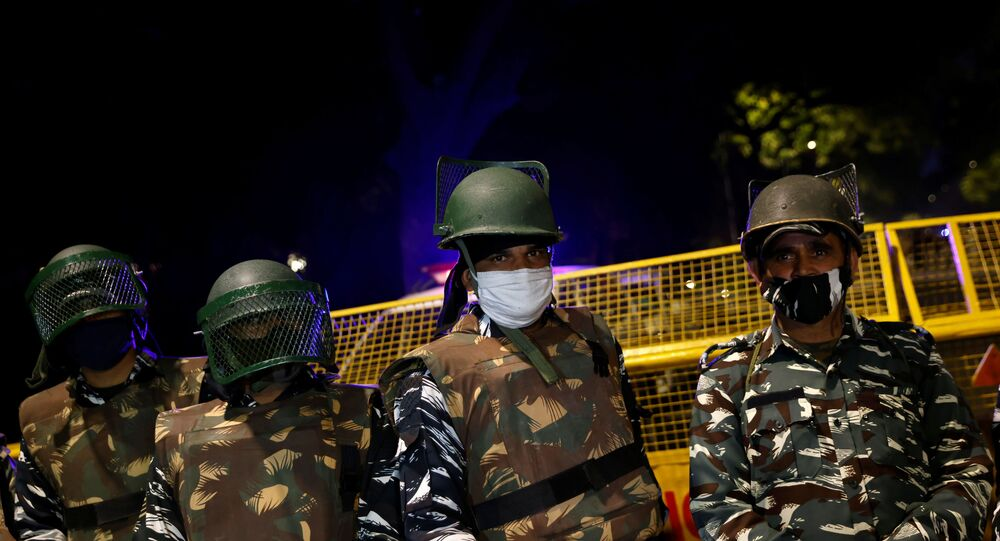 Paramilitary troops stand guard after an explosion near the Israeli embassy in New Delhi, India, 29 January 2021.