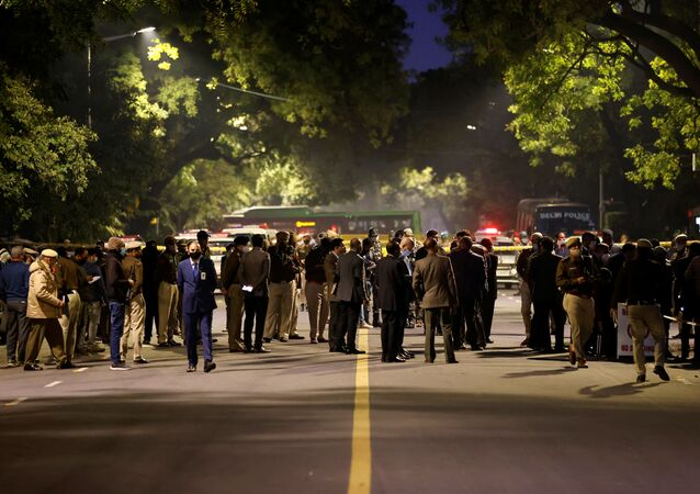 Security officials are seen at the site of an explosion near the Israeli embassy in New Delhi, India, January 29, 2021.