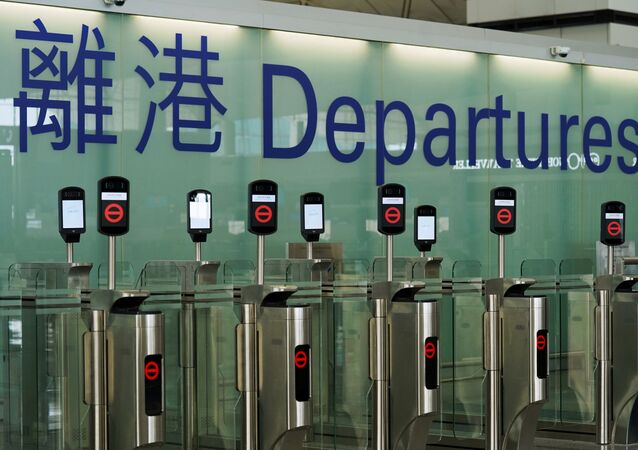 Closed counters are seen at the departures hall of Hong Kong International Airport