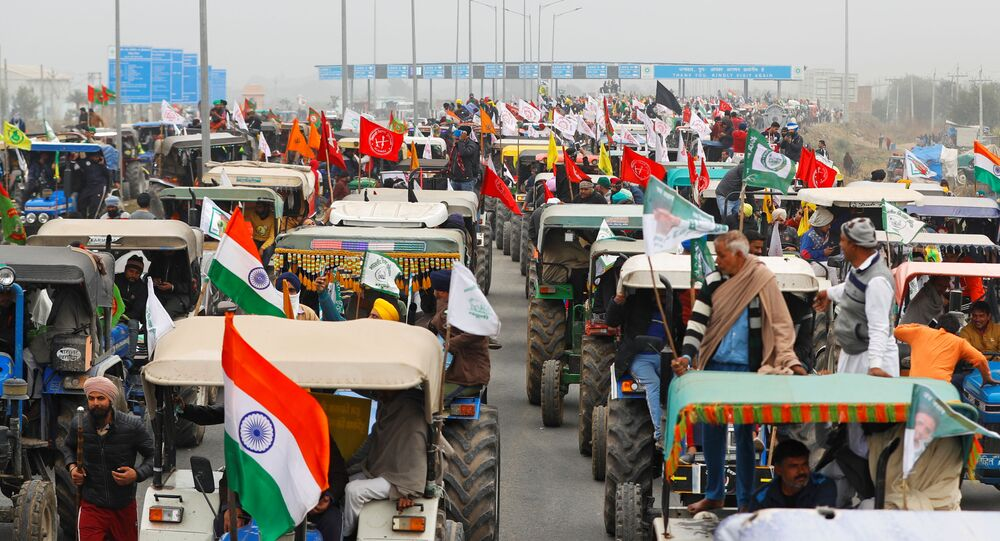 FILE PHOTO: Farmers participate in a tractor rally to protest against the newly passed farm bills, on a highway on the outskirts of New Delhi, India, January 7, 2021.