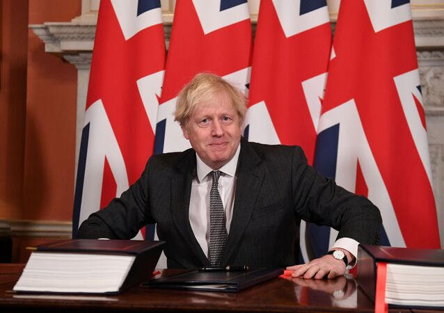 Britain's Prime Minister Boris Johnson reacts after signing the Brexit trade deal with the EU