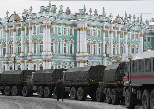A convoy of military vans on Palace Square in Saint Petersburg ahead of unauthorised rally in support of opposition figure Alexey Navalny, 31 January 2021