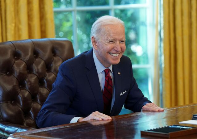 U.S. President Joe Biden smiles after signing executive orders strengthening access to affordable healthcare at the White House in Washington, U.S., January 28, 2021