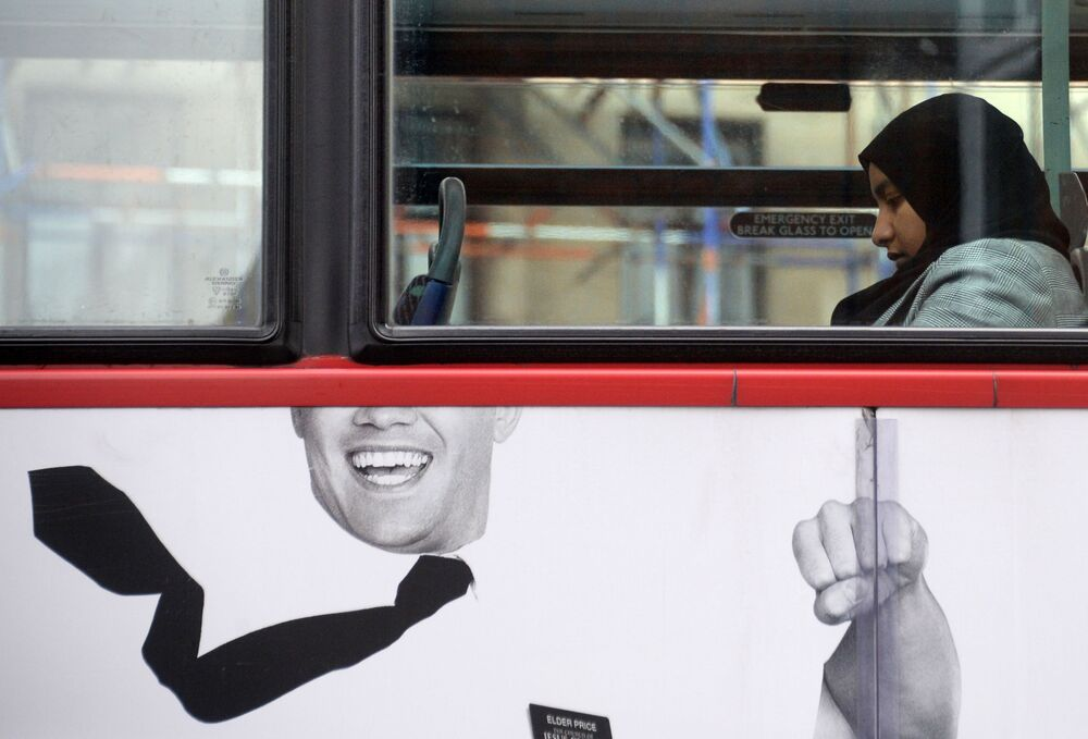A Muslim woman on a bus in London.
