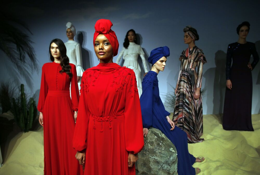 Halima Aden, a hijab wearing model from the United States, and other models feature creations by designer Rasit Bagzibagli for Modanisa, an online retailer of modest fashion, during a fashion show in Istanbul, Monday, 26 March, 2018.