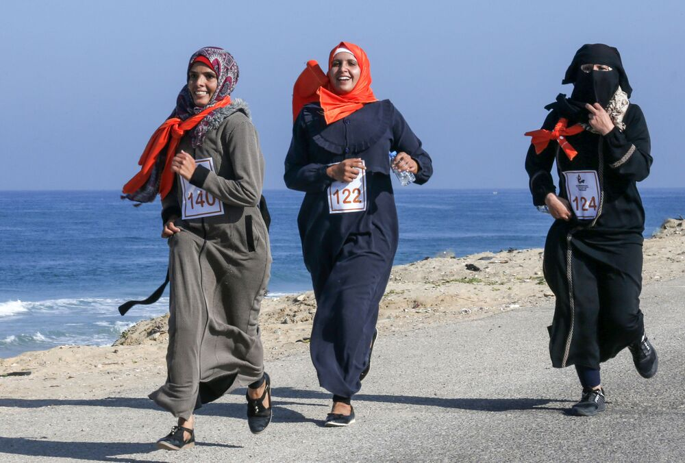 Palestinian women take part in a marathon calling for an end to violence against women, in Khan Yunis in the southern Gaza Strip on 1 December 2019.