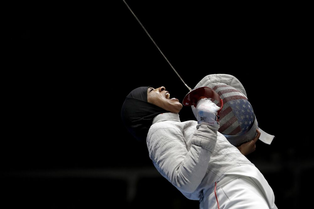 Ibtihaj Muhammad celebrates after winning a point against Russia in a women's team sabre fencing semifinal at the 2016 Summer Olympics in Rio de Janeiro, Brazil.