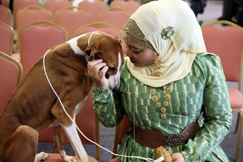 Retired Philadelphia police officer Aliya Taylor poses with her Azawakh named Bahir at a Westminster Kennel Club news conference in New York.