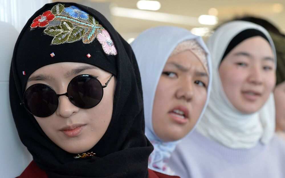 Kyrgyz Muslim women wearing hijab look on as they take part in celebrations for World Hijab Day in Bishkek on 1 February 2019.