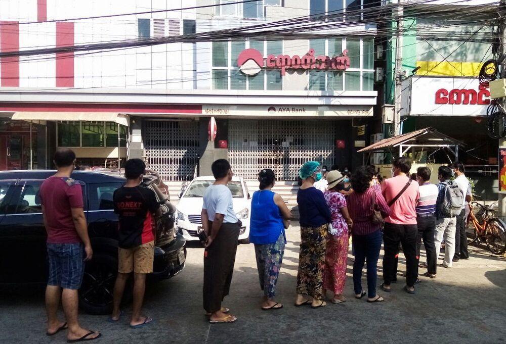 People line up outside a bank branch in Yangon, Myanmar 1 February 2021.