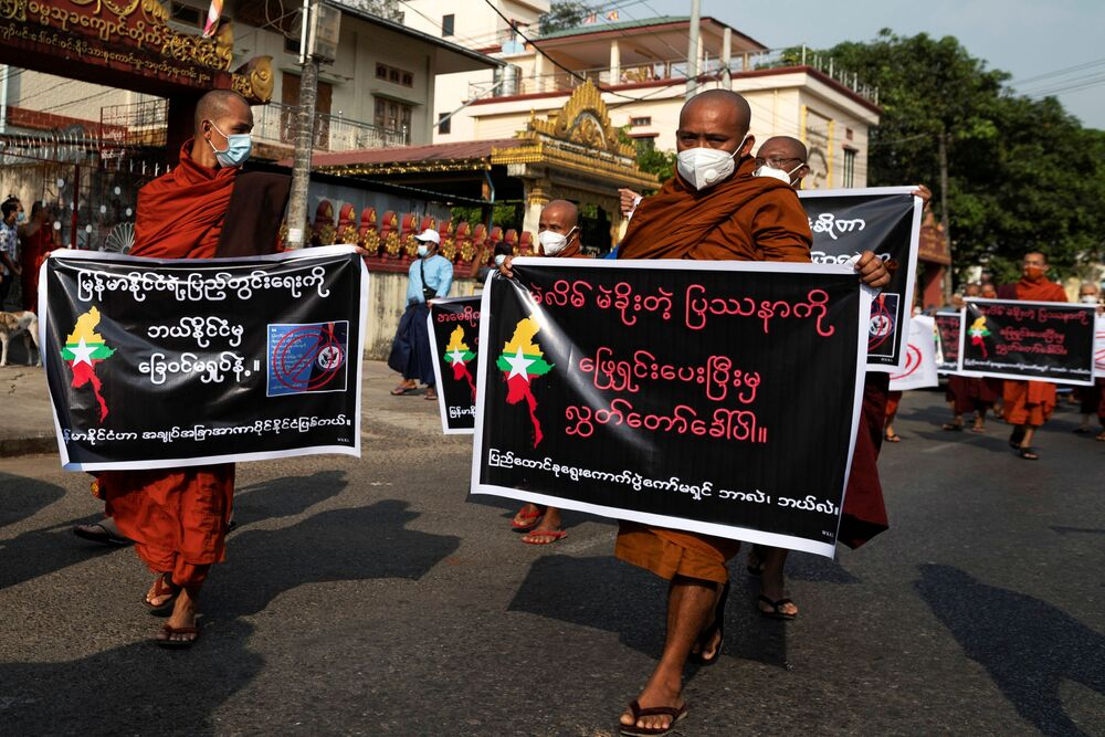 Buddhist monks, supporters of Myanmar's military, take part in a protest against Union Election Commission, the elected government and foreign embassies in Yangon, Myanmar, 30 January 2021.