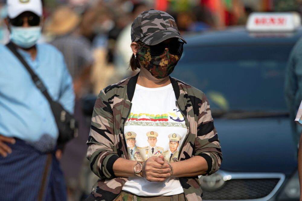 A supporter of Myanmar's military takes part in a protest against Union Election Commission, the elected government and foreign embassies in Yangon, Myanmar, 30 January 2021.