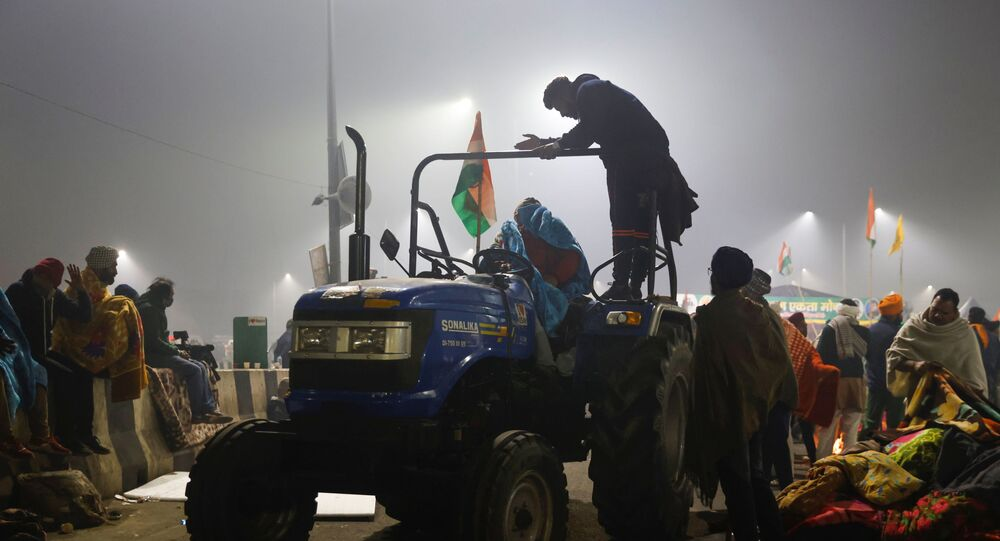 Farmers arrive with blankets and mattresses for others at the site of a protest against farm laws at Ghaziabad, India.