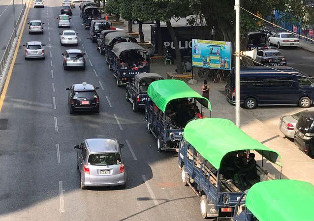Myanmar police vehicles drive near the City Hall in Yangon, Myanmar February 1, 2021.