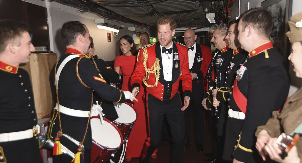 Britain's Prince Harry and Meghan, Duchess of Sussex, meet the Massed Bands of Her Majesty's Royal Marines at the Mountbatten Festival of Music at the Royal Albert Hall in London, Saturday, March 7, 2020