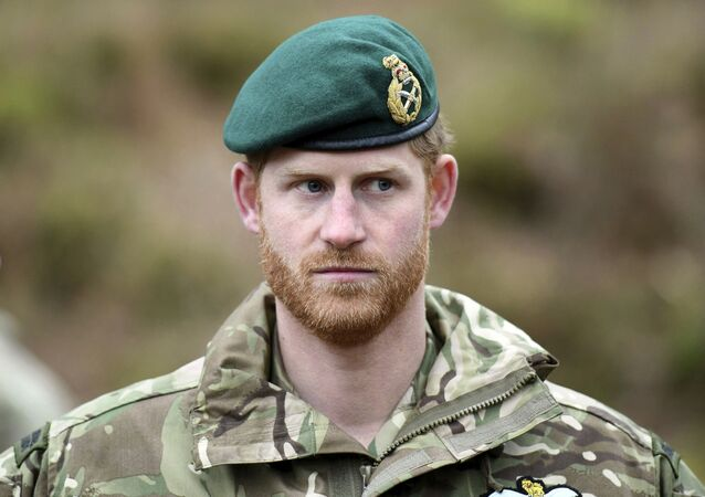 Britain's Prince Harry, the Duke of Sussex looks on during a visit to 42 Commando Royal Marines at their base in Bickleigh, in Devon,  England, Wednesday, Feb. 20, 2019