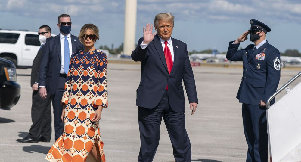 Former President Donald Trump and Melania Trump waves upon arrival at Palm Beach International Airport in West Palm Beach, Florida., Wednesday, 20 January 2021