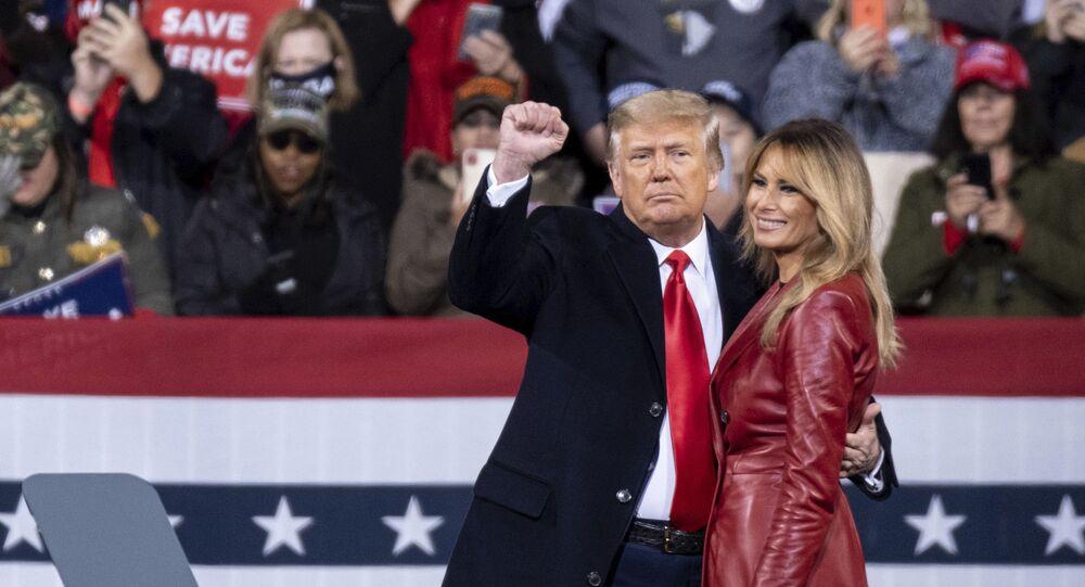 President Donald Trump and first lady Melania Trump prepare to leave a rally for U.S. Senators Kelly Loeffler, R-Ga., and David Perdue, R-Ga., who are both facing runoff elections Saturday, Dec. 5, 2020