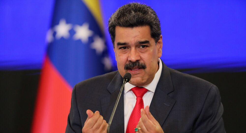 Venezuelan President Nicolas Maduro gestures as he speaks during a news conference following the ruling Socialist Party's victory in legislative elections that were boycotted by the opposition in Caracas, Venezuela December 8, 2020.