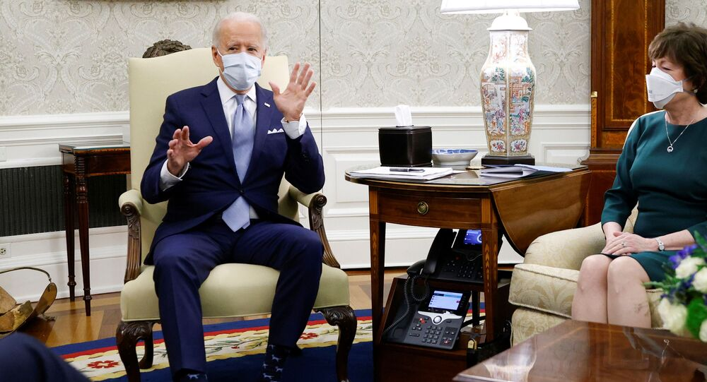 Senator Susan Collins (R-ME) looks over at U.S. President Joe Biden and Vice President Kamala Harris, not pictured, during a discussion on coronavirus disease (COVID-19) federal aid legislation inside the Oval Office at the White House in Washington, U.S., February 1, 2021.