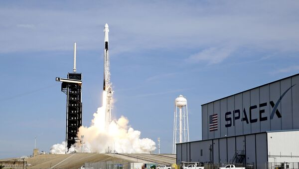 A SpaceX Falcon 9 rocket on a resupply mission to the International Space Station lifts off from pad 39A at the Kennedy Space Center in Cape Canaveral, Fla., Sunday, Dec. 6, 2020. - Sputnik International