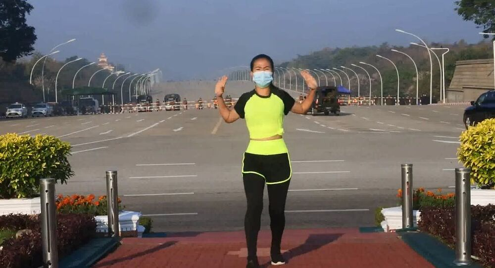 Khing Hnin Wai filming aerobics while the military coup is unfolding behind her back in Myanmar, February 2021