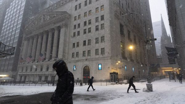 People walk past the New York Stock Exchange during a snowstorm, Monday, Feb. 1, 2021, in New York.  - Sputnik International