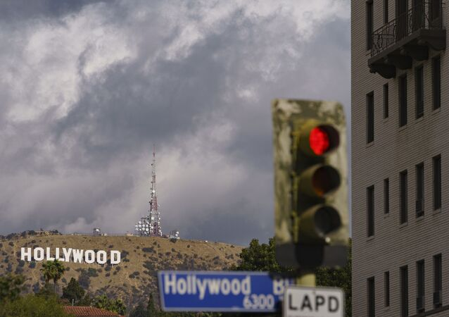 In this Nov. 7, 2020, file photo, clouds move over the Hollywood sign in Los Angeles. The raging coronavirus pandemic has prompted Los Angeles County to impose a lockdown to prevent the caseload from spiraling into a hospital crisis but the order stops short of a full business shutdown that could cripple the holiday sale season.