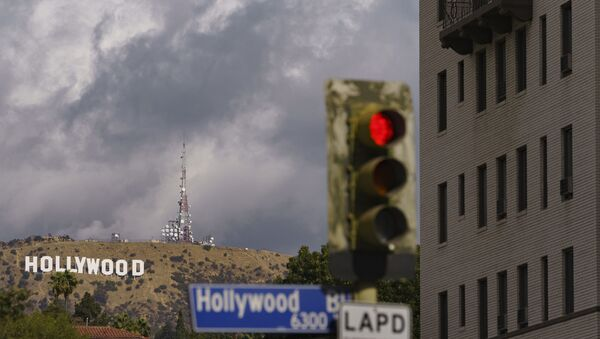 In this Nov. 7, 2020, file photo, clouds move over the Hollywood sign in Los Angeles. The raging coronavirus pandemic has prompted Los Angeles County to impose a lockdown to prevent the caseload from spiraling into a hospital crisis but the order stops short of a full business shutdown that could cripple the holiday sale season. - Sputnik International