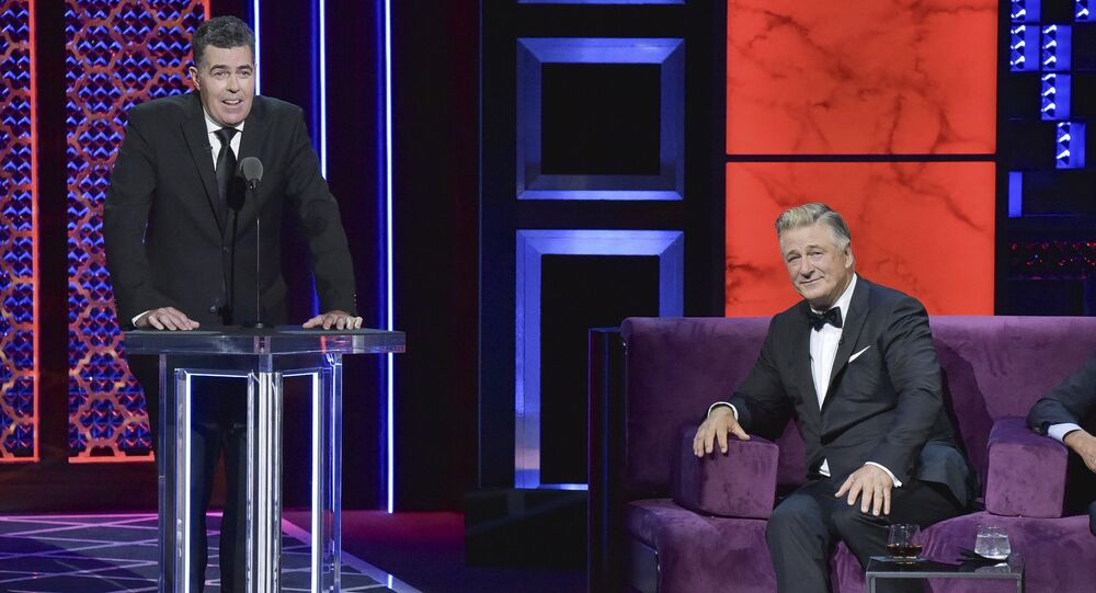 Adam Carolla, from left, Alec Baldwin participates in the Comedy Central roast of Alec Baldwin at the Saban Theatre on Saturday, Sept. 7, 2019