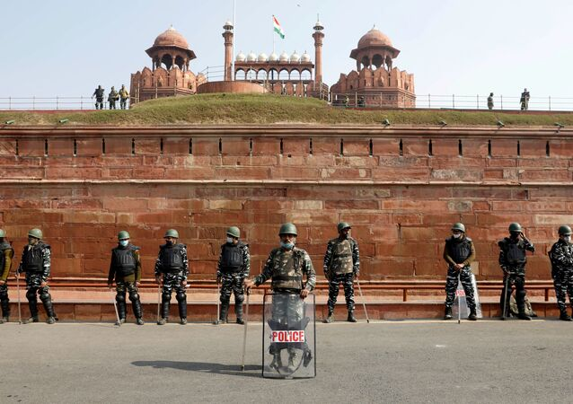 Policemen stand guard in front of the historic Red Fort after Tuesday's clashes between police and farmers, in the old quarters of Delhi