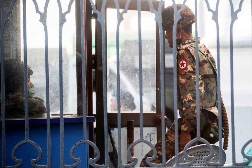 Myanmar soldiers stand inside Yangon City Hall after they occupied the building, Yangon, Myanmar 2 February 2021.