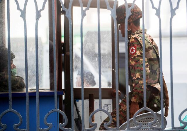 Myanmar soldiers stand inside Yangon City Hall after they occupied the building, in Yangon, Myanmar February 2, 2021.