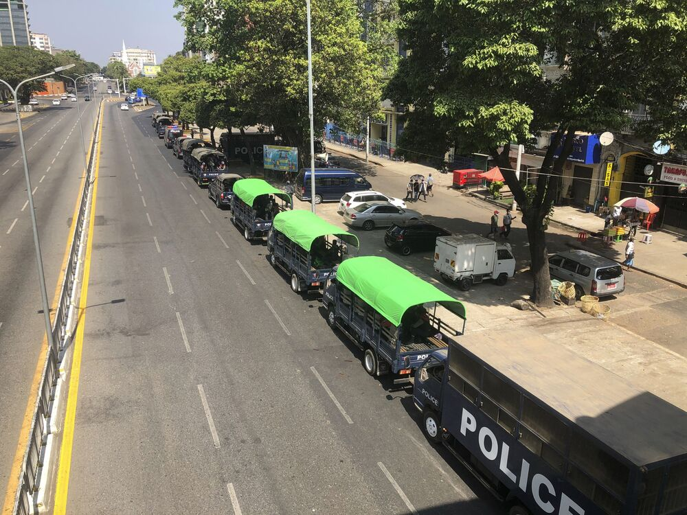 Police trucks parked at the Kyauktada police station in Yangon, Myanmar Monday, 1 February, 2021. Myanmar military television said Monday that the military was taking control of the country for one year, while reports said many of the country's senior politicians including Aung San Suu Kyi had been detained.