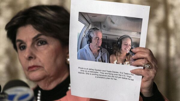 Attorney Gloria Allred, holds a picture of Jeffrey Epstein and her client Teala Davis during a news conference, Thursday, Nov. 21, 2019, in New York, about the filing of a lawsuit against the estate of Epstein. Davies says she was 17 when she was victimized by Epstein - Sputnik International