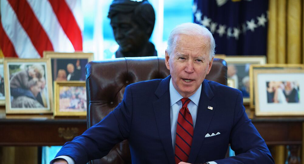 US President Joe Biden speaks before signing executive orders on health care, in the Oval Office of the White House in Washington, DC, on January 28, 2021.