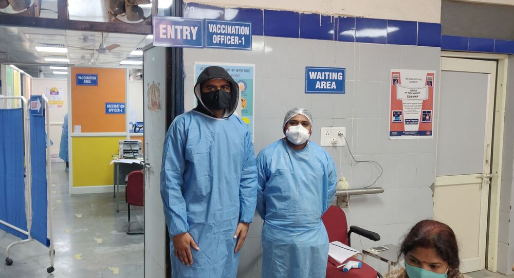 Vaccinating Officers at Delhi's Guru Gobind Singh Government Hospital.