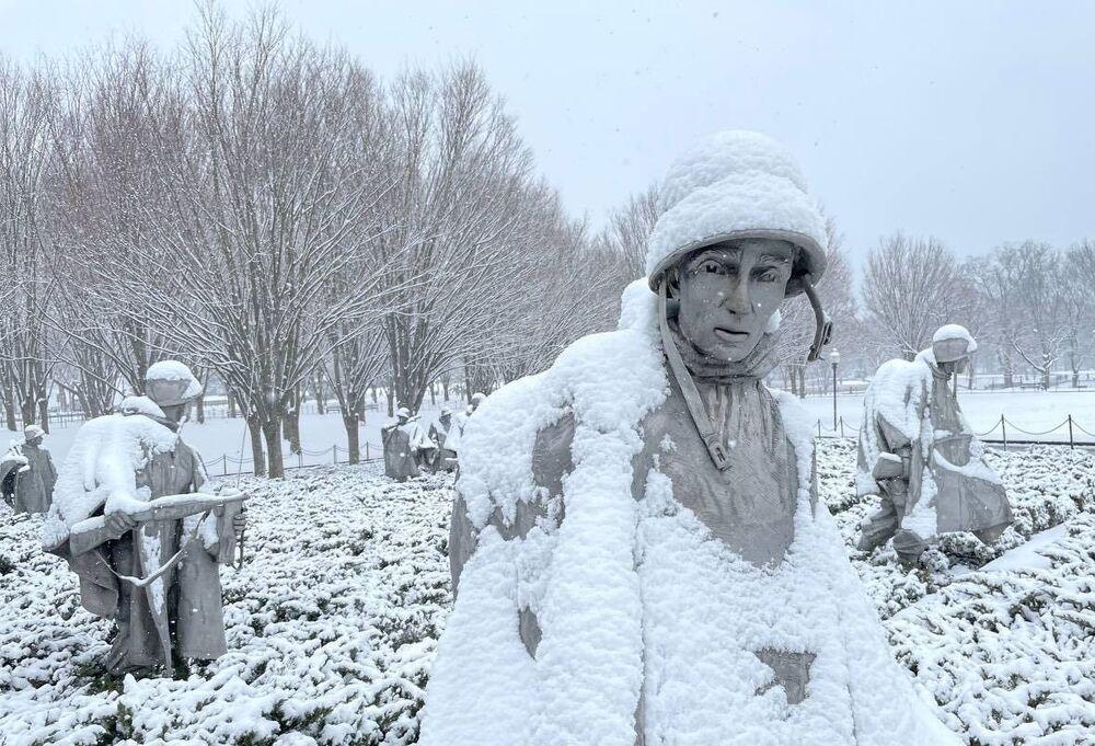 The Korean War Veterans Memorial covered in snow.