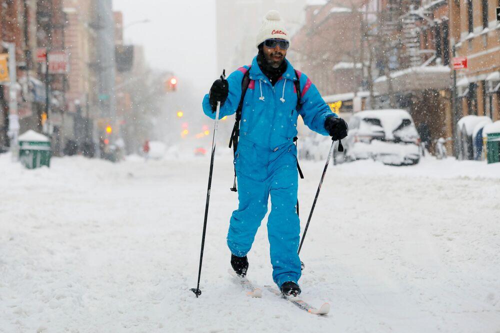 A man skis through the East Village during the coronavirus outbreak, in the Manhattan borough of New York City, New York, U.S., 1 February 2021.