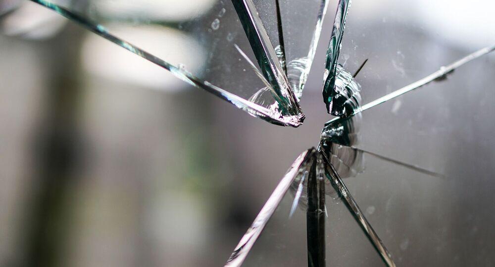 Cracks in glass after gunshot