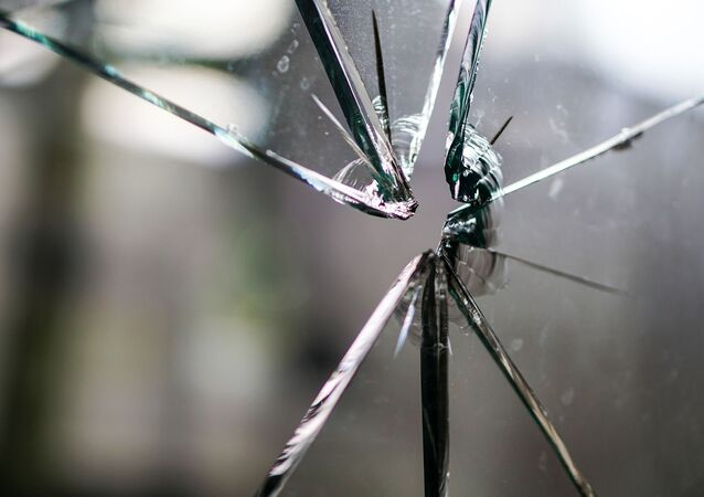 Cracks in glass after gunshot