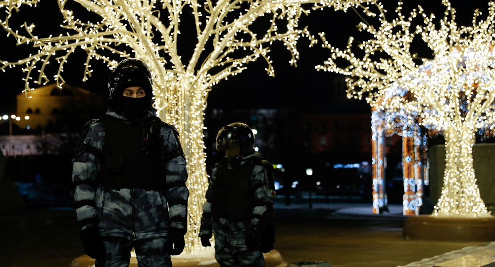Riot police officers stand guard during a demonstration after Russian opposition leader Alexei Navalny was sentenced to three and a half years in jail, in Moscow, Russia February 2, 2021.