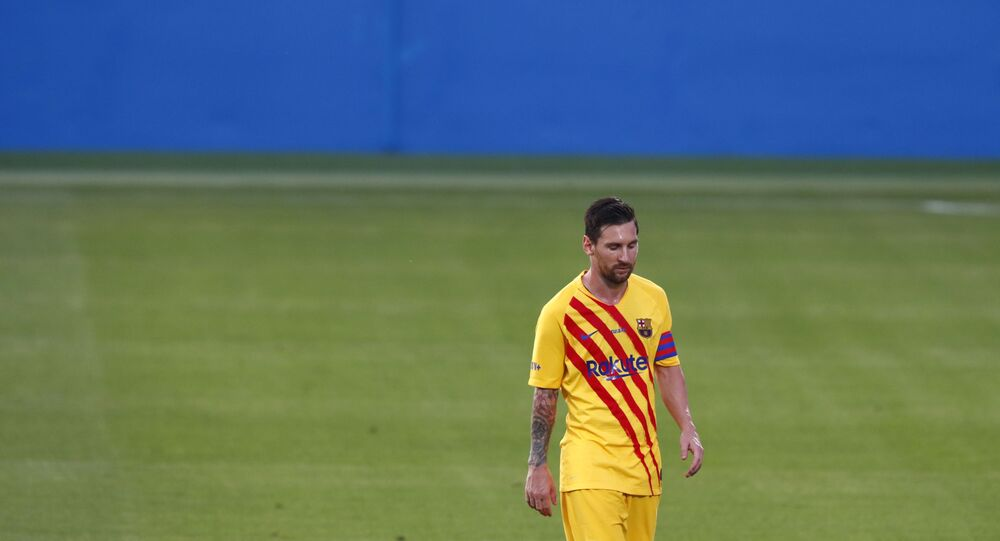 Barcelona's Lionel Messi leaves the field at half time during the pre-season friendly soccer match between Barcelona and Gimnastic at the Johan Cruyff Stadium in Barcelona, Spain, Saturday, Sept.12, 2020.