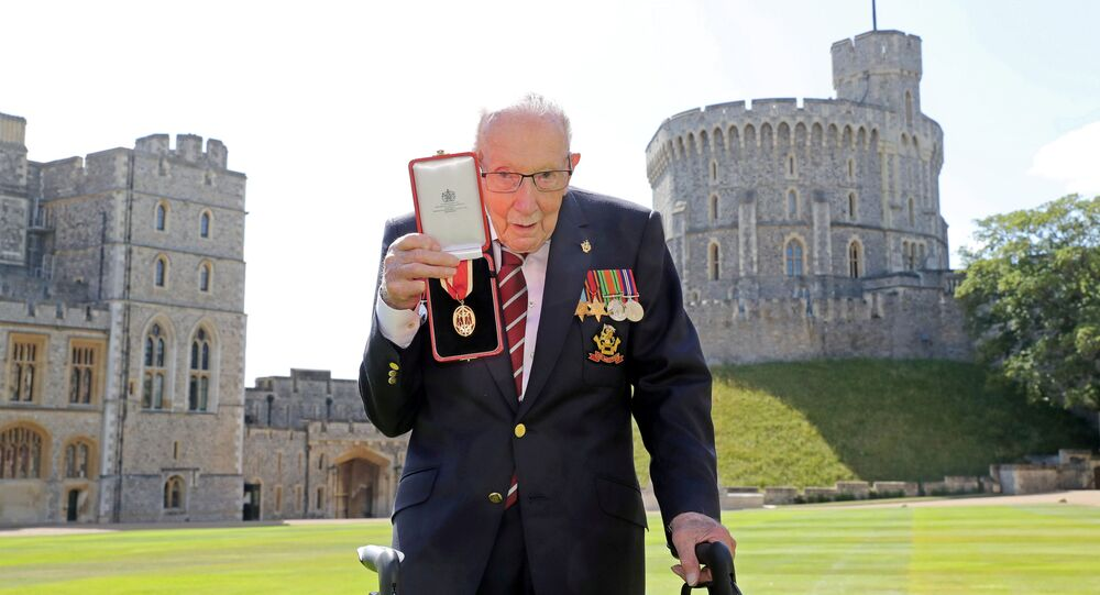 Captain Tom Moore poses after being awarded with the insignia of Knight Bachelor by Britain's Queen Elizabeth at Windsor Castle, in Windsor, Britain July 17, 2020.