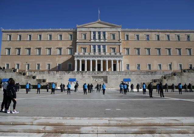 Police guard the Greek parliament during a rally organised by students and teachers against education reforms in Athens, Thursday, Jan. 28, 2021